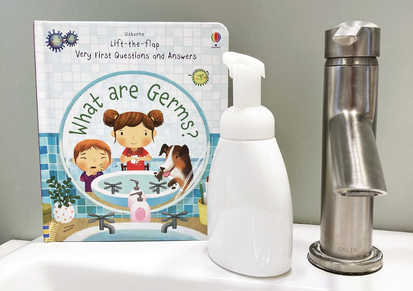 Pandemic kid book next to hand soap and faucet
