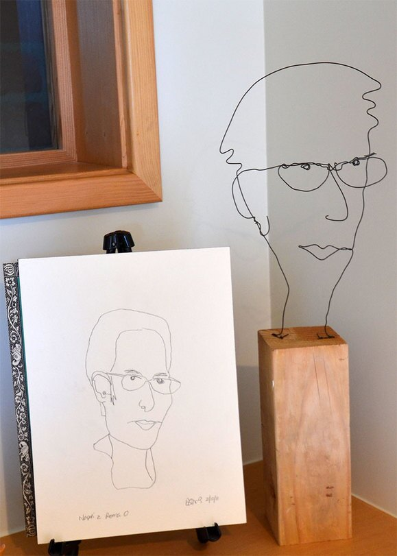 "Left: Mr. Bonzai, ""Keiko Napoli 46b"" 2011, 10"" x 8""  pencil on paper. Right: ""Wire Portrait 46b""  2011, 18"" x  4"" x 4""  Black Wire, Douglas Fir"
