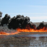 Just another day in North Dakota: an oil spill burns in a wildlife refuge in 2010 | Photo: USFWS