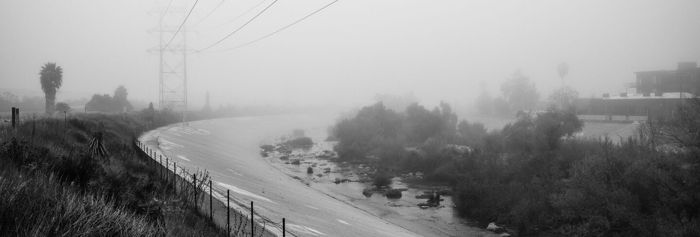 The L.A. River is seen from the Bowtie Parcel on a foggy winter morning