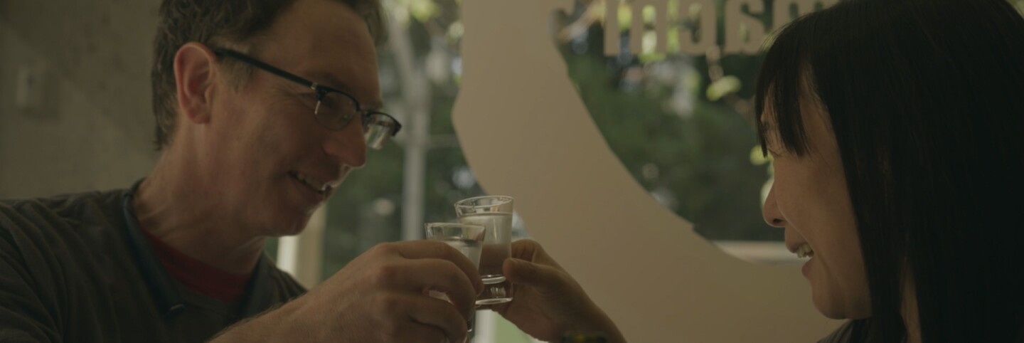 "Jake Myrick and Noriko Kamei enjoying their freshly brewed sake | Still from ""The Migrant Kitchen"" Sequoia Sake"