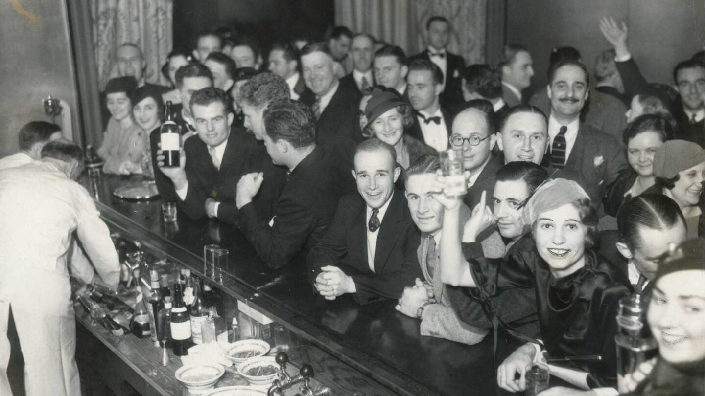Men and women raising their glasses during Prohibition-era | Los Angeles Examiner Photographs Collection,University of Southern California Libraries