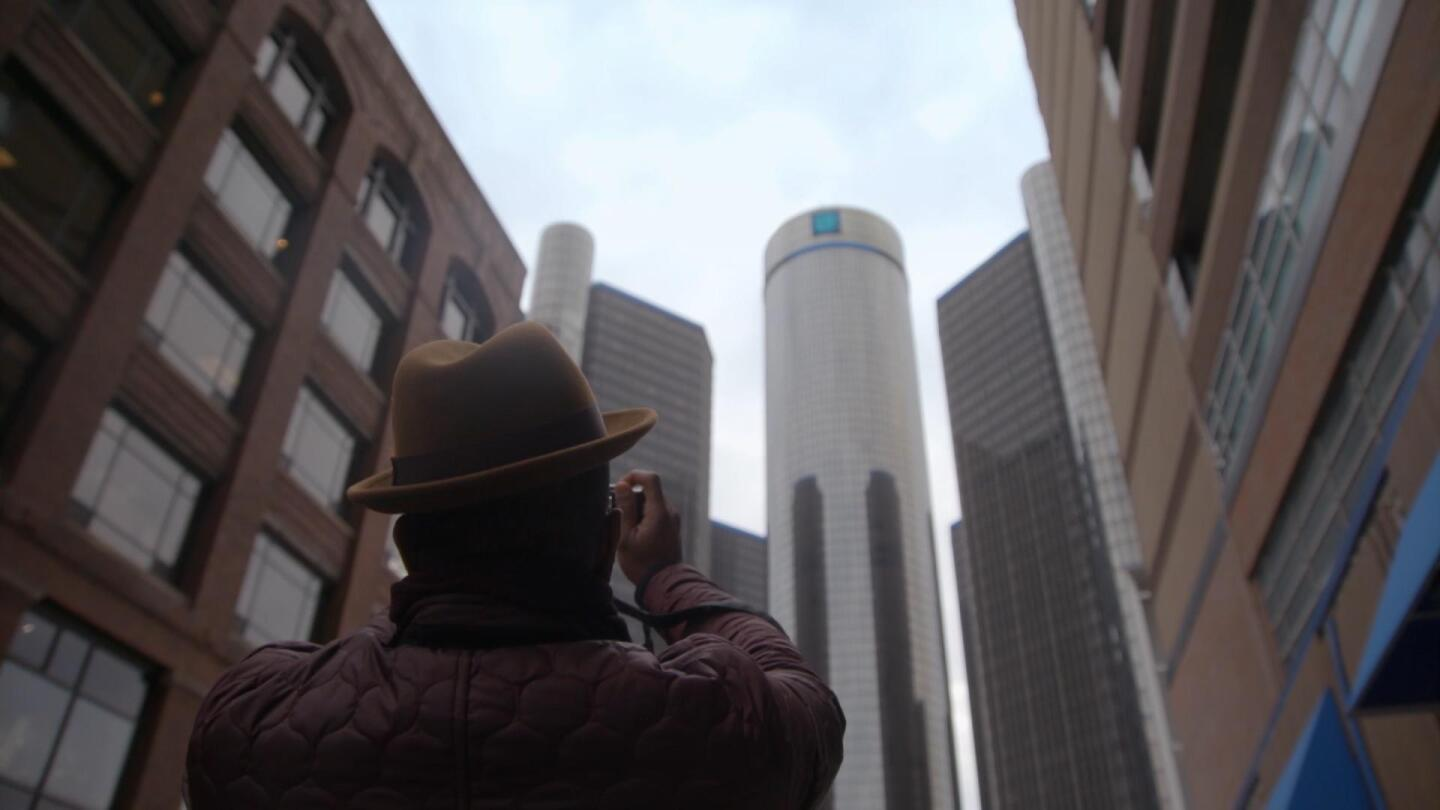 """""""Family Pictures USA"""" host Thomas Allen Harris aims his camera at a city building. 