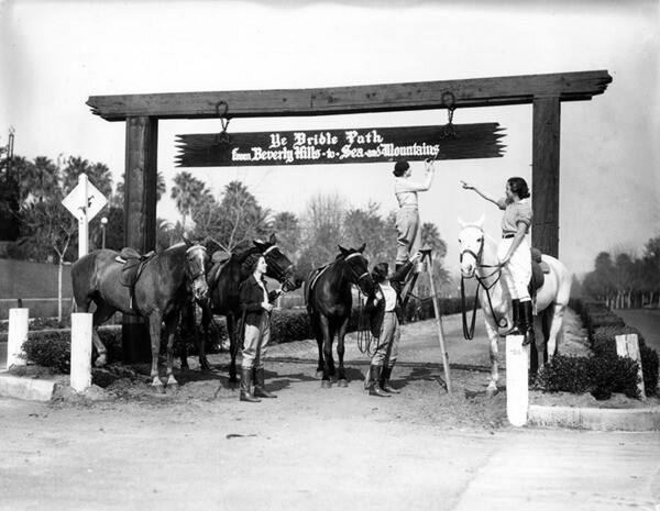 A sign over the entrances to the bridle paths proclaimed, perhaps somewhat misleadingly, that they led 'to the mountains and the sea.' Courtesy of the Security Pacific National Bank Collection - Los Angeles Public Library.