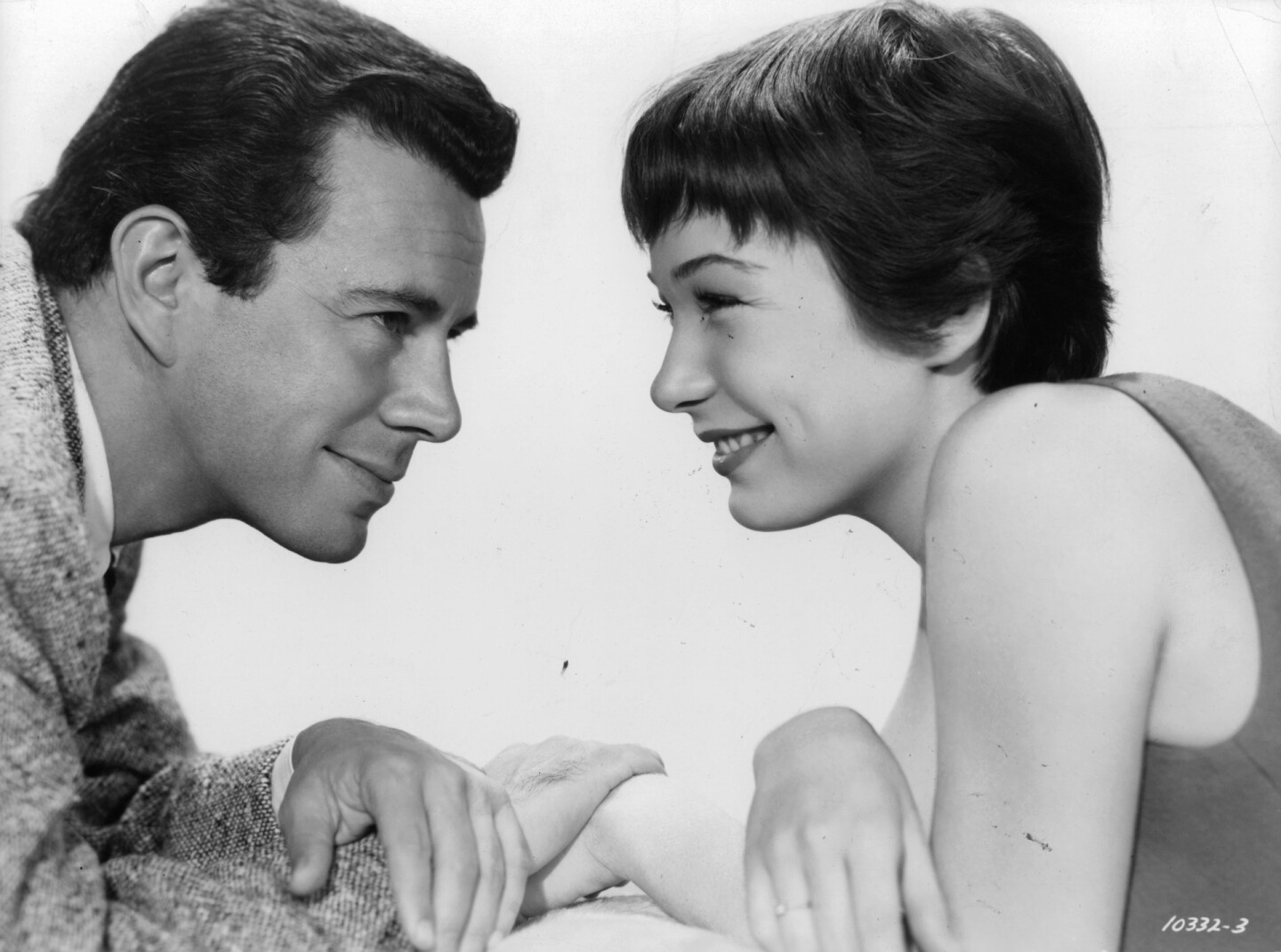 "John Forsythe and Shirley MacLaine looking into each other's eyes in a scene from the film ""The Trouble With Hary,"" 1955."