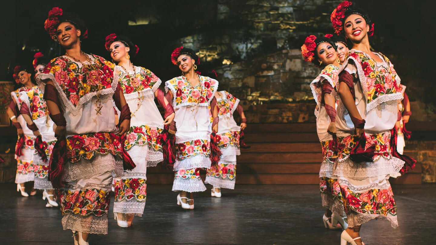 Pacifico Dance Company gives audiences a glimpse into the dance of Yucatan. Dancers wearing large flowers on their hair and dresses. | Courtesy of Pacifico Dance Company
