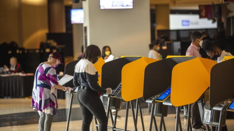 Voters cast their ballots at the vote center inside Staples Center. | Chava Sanchez/LAist