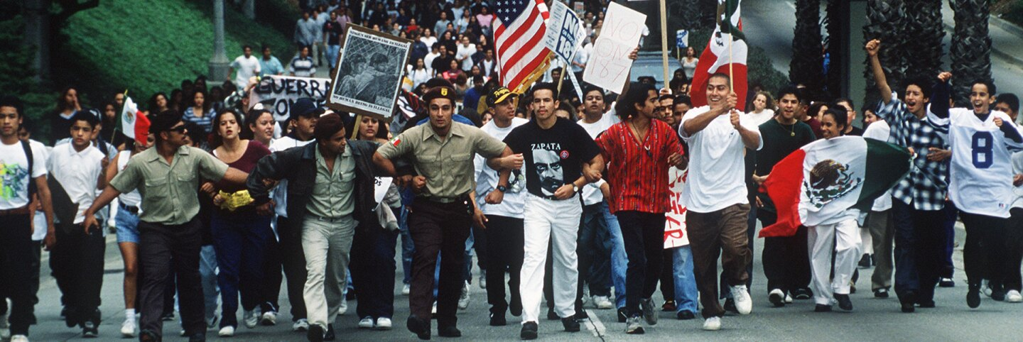 Hundreds of Fullerton College students march through Fullerton, California protesting Proposition 187 on November 2, 1994. | Bruce Chambers / MediaNews Group / Orange County Register via Getty Images