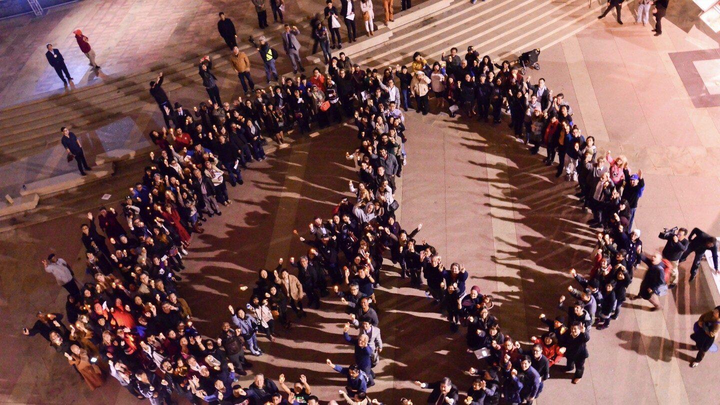 A Vigilant Love rally gathers in the shape of a peace sign in Little Tokyo, Los Angeles.