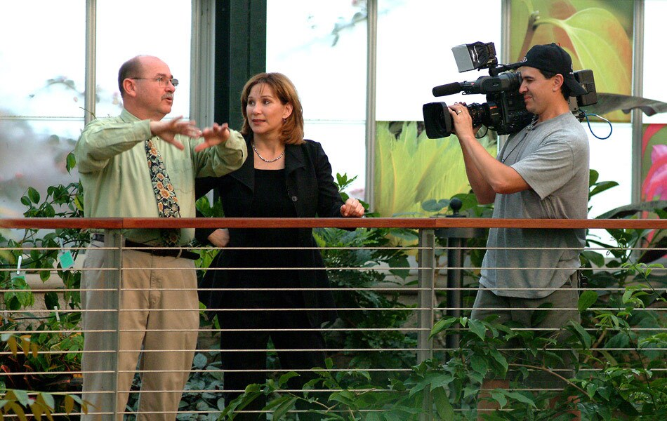 Val Zavala Outside with a Camera Operator and an Interview Subject
