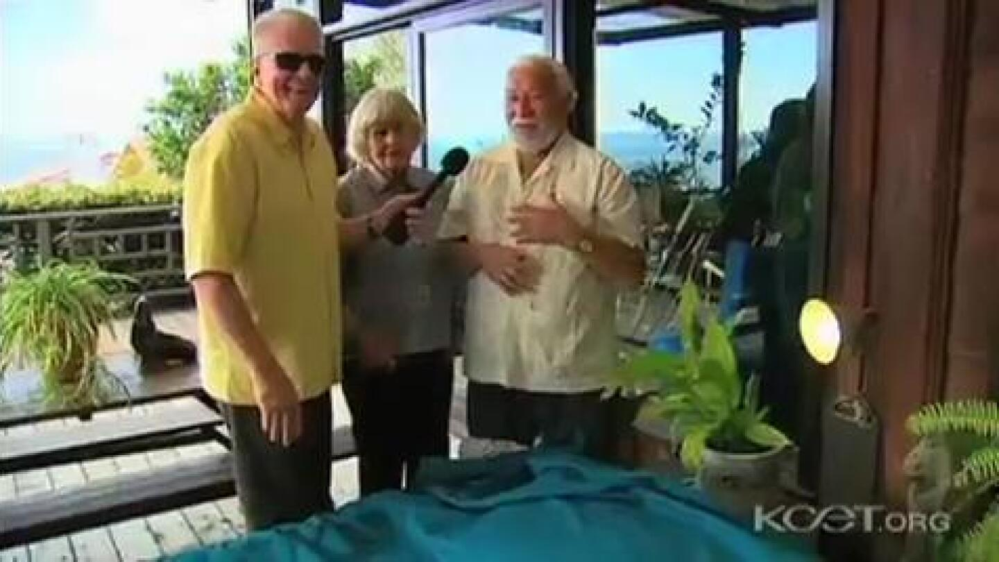 Huell Howser speaks to a couple who likes sleeping outside every night.