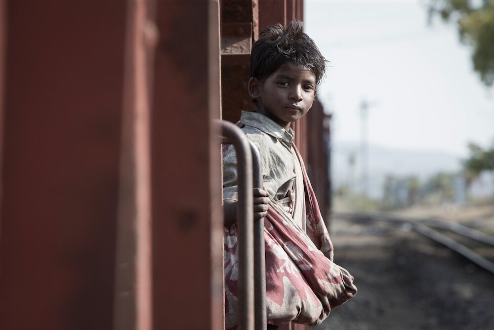 "Sunny Pawar (as a young Saroo Bierley) in the film ""Lion."""