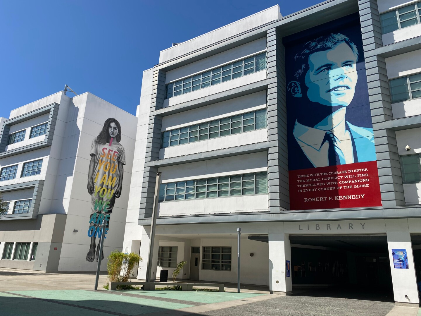 Murals of a student and Robert Kennedy on the side of Los Angeles High School of the Arts.