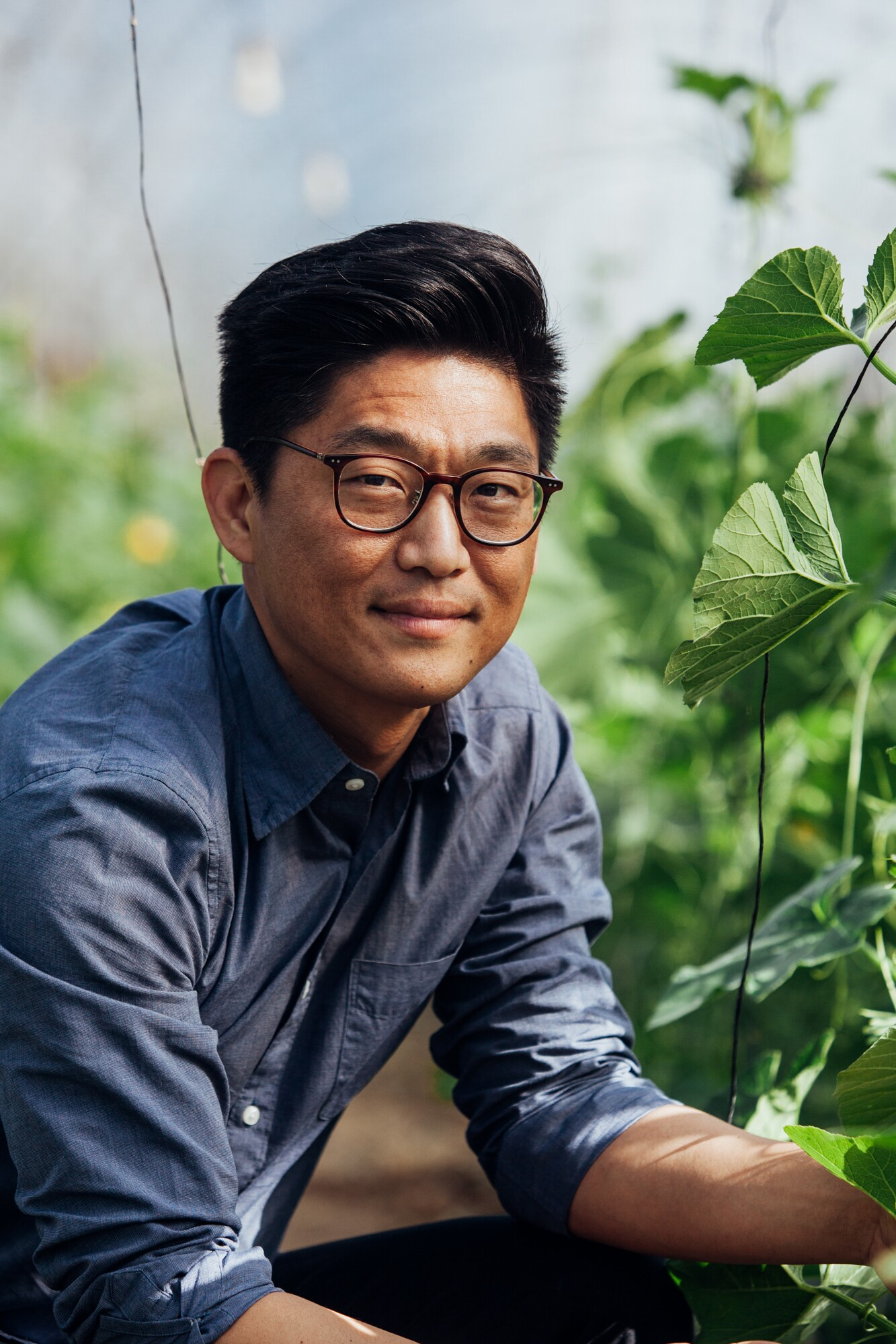 Aaron Choi smirks among his fields of crops in his California location of Girl & Dug Farm.