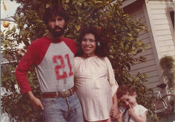 The Guzmán family in 1982 with Nicholas wearing the belt buckle.