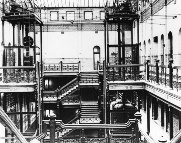 The Bradbury Building's iconic ferrous interior features ornamental wrought iron railings from the Llewellyn Iron Works and elevators built by the Baker Iron Works. Undated photo courtesy of the Photo Collection - Los Angeles Public Library.