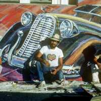 East Los Streetscapers Wayne Healy, David Botello, and George Yepes (left to right) complete Filling Up on Ancient Energies, 1980 | Courtesy of the artists Murales Rebeldes 16 x 9