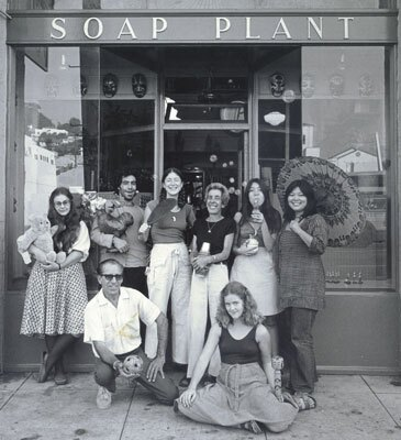 A black and white photo of Barbara Shire, center, with friends and family in front of the original Soap Plant storefront on Sunset Blvd in the 1970s.