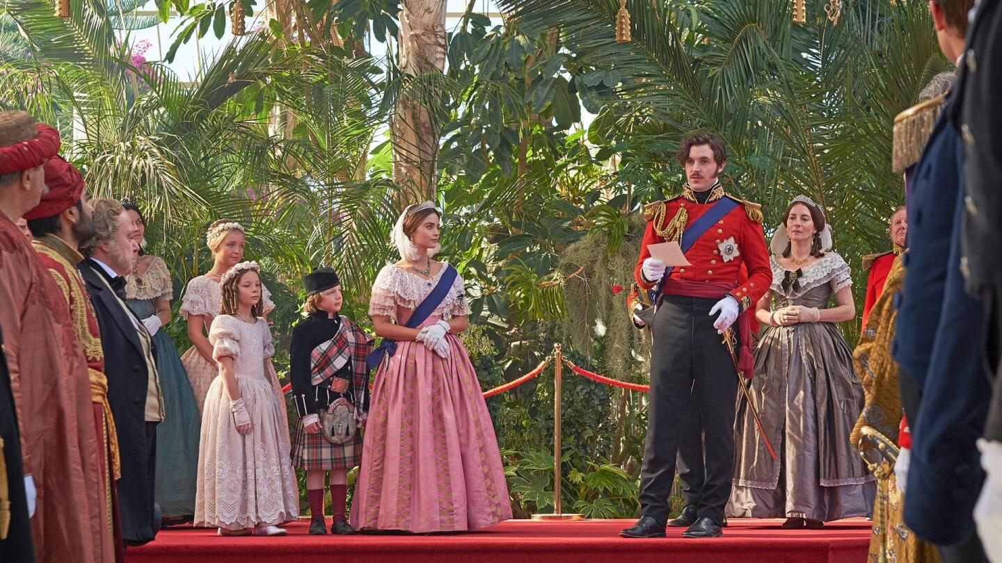 "Prince Albert (Tom Hughes) addresses a crowd while Queen Victoria (Jenna Coleman) and her children watch him at his side. | ""Victoria Season 3 on Masterpiece: The White Elephant"""