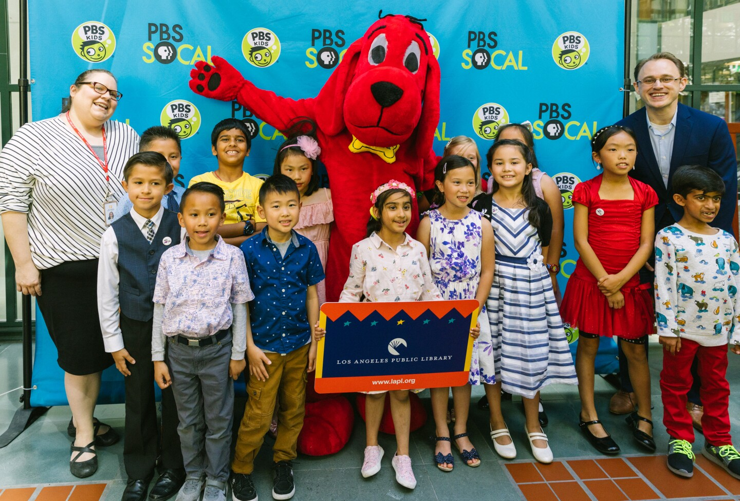Winners pose for photos with Clifford the Big Red Dog | Courtesy of Mae Koo Photography