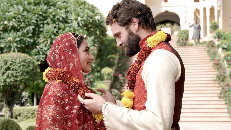 "Chandrika (Pallavi Sharda) and John Beecham (Tom Bateman) happily look into each other's eyes. | ""Beecham House on Masterpiece: Episode 4"""