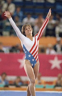 At the 1984 L.A. Ollympics, Mary Lou Retton became the first Americanwoman ever to win an individual gold medal in gymnastics. | photo by Lionel Cironneau/Associated Press