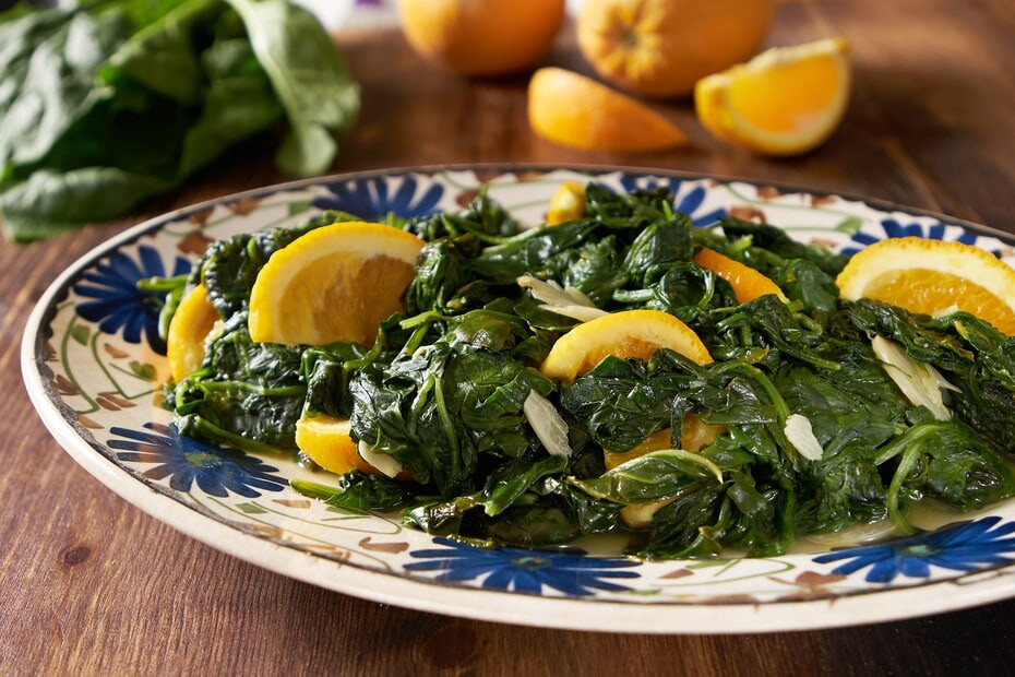spinach cooked with oranges and garlic