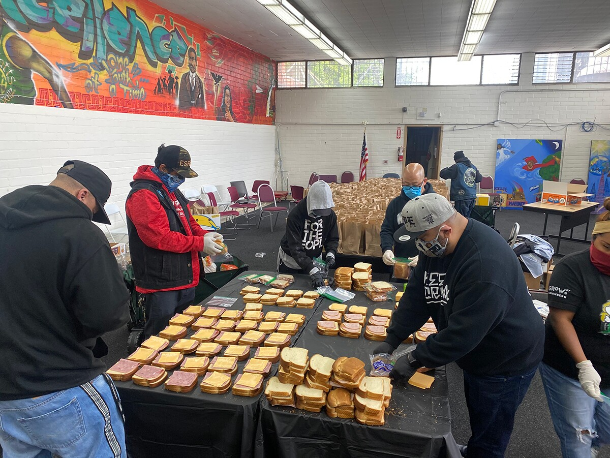 Members of East Side Riders Bike Club assemble meal packages  | Courtesy of East Side Riders