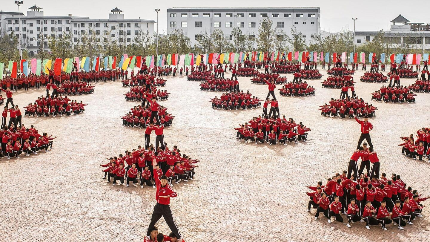 Thousands of Shaolin Kung-Fu students performing in perfect synchronicity.
