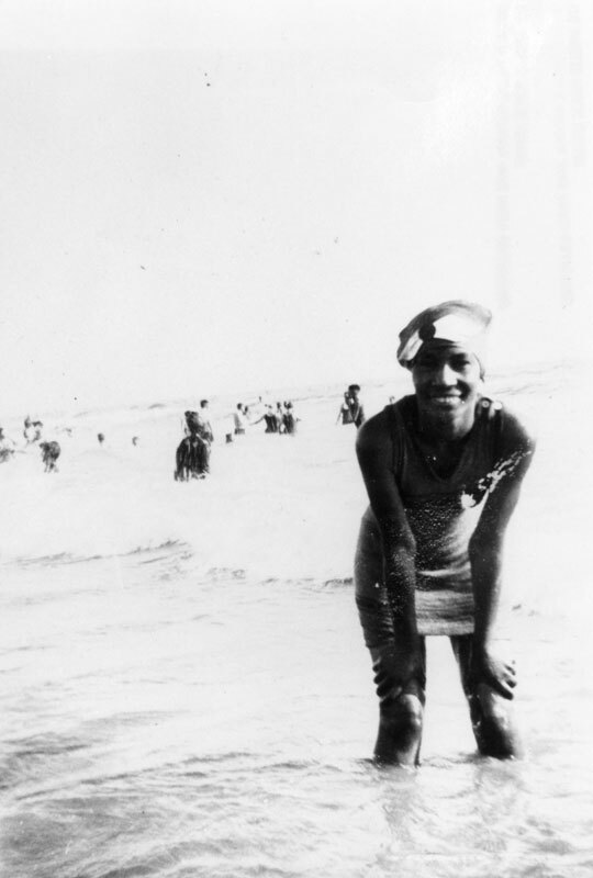 Mary Mingeleton enjoys the surf at Manhattan Beach, possibly at the African American resort of Bruces' Beach shortly before it was condemned by the city. Courtesy of the Shades of LA Collection, Los Angeles Public Library.