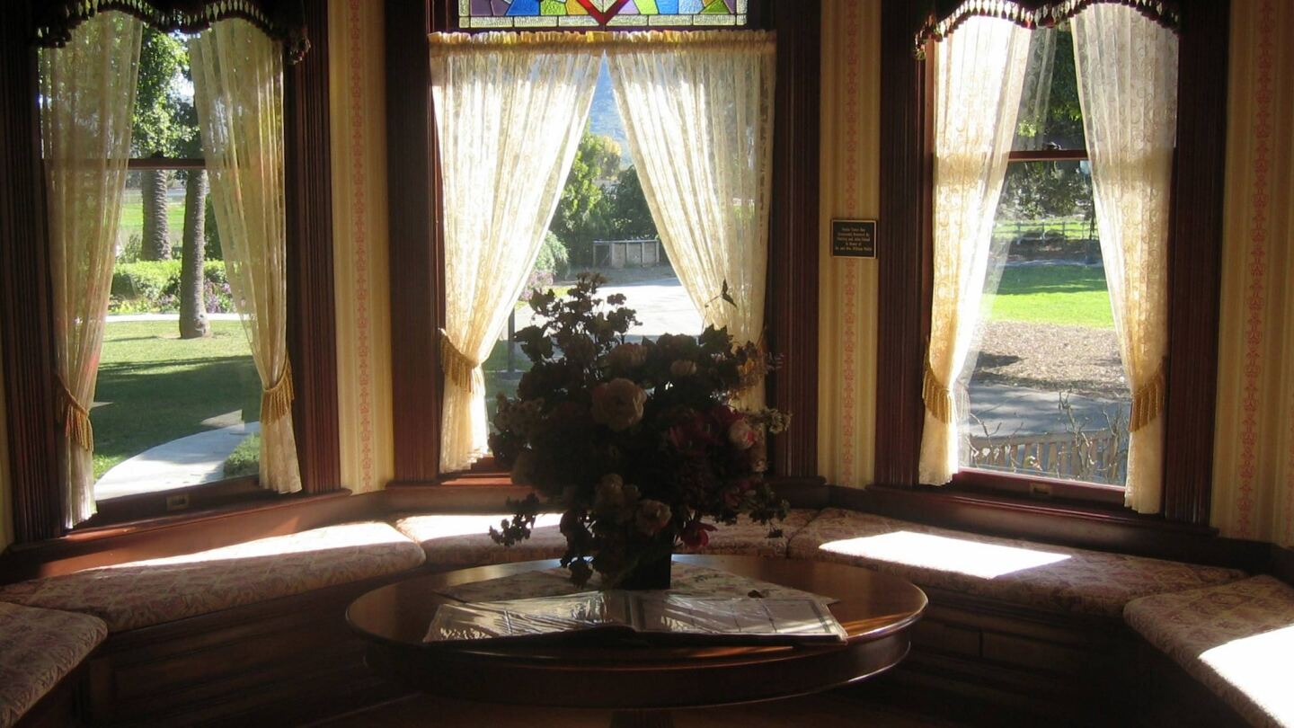 Interior shot of the Camarillo House with a vase of flowers placed on a table.