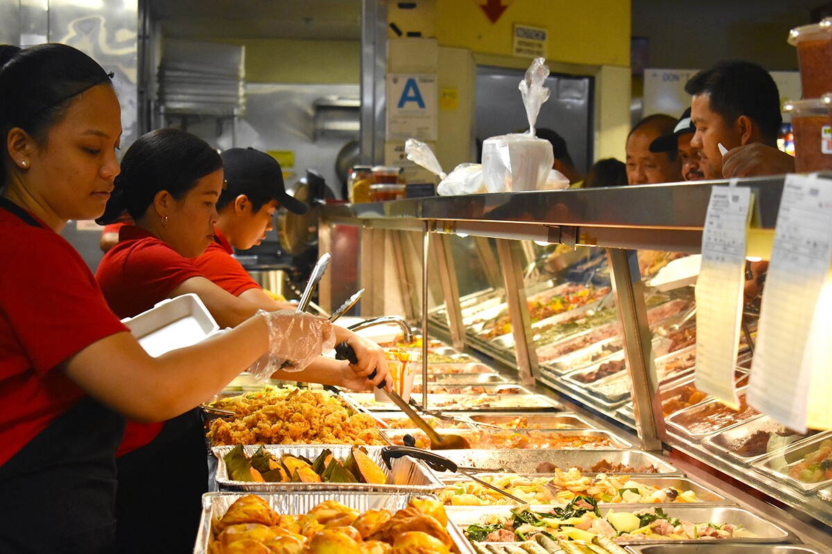Arko Foods Market's workers serving customers in the turo-turo section. | Jacqueline Lee