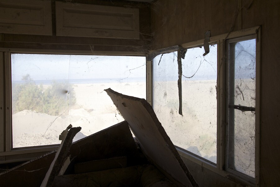 """Window View - Abandoned Mobile Home."" Salton Sea, CA. 2014. | Photo: Osceola Refetoff."
