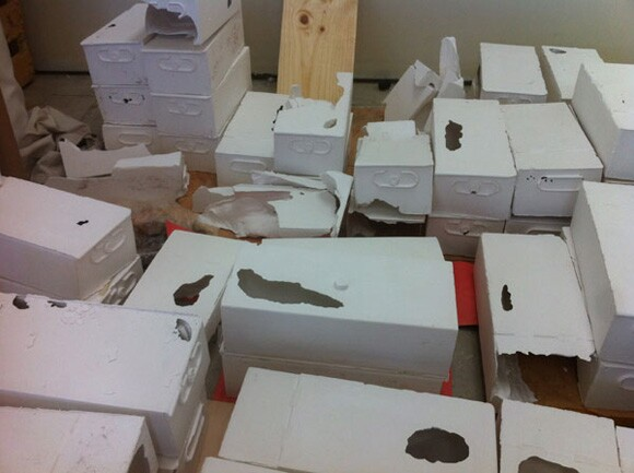 Plaster casts of safe deposit boxes in Liz Glynn's studio | Photo: Sharon Mizota.<br />