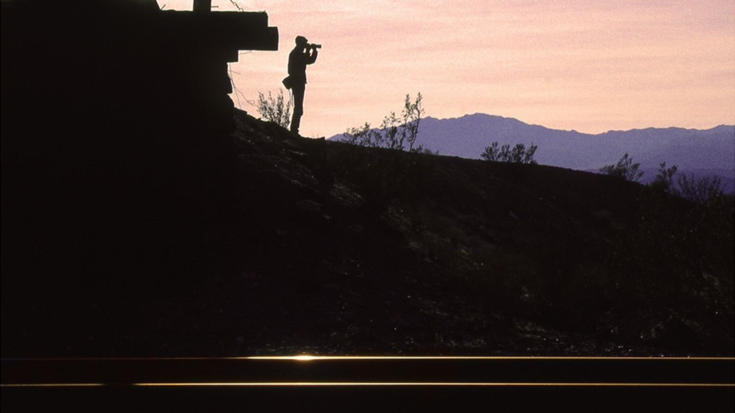 Richard Steinheimer toting his heavy camera bag and photographing another sunset, at Lavic in the Mojave. | Shirley Burman