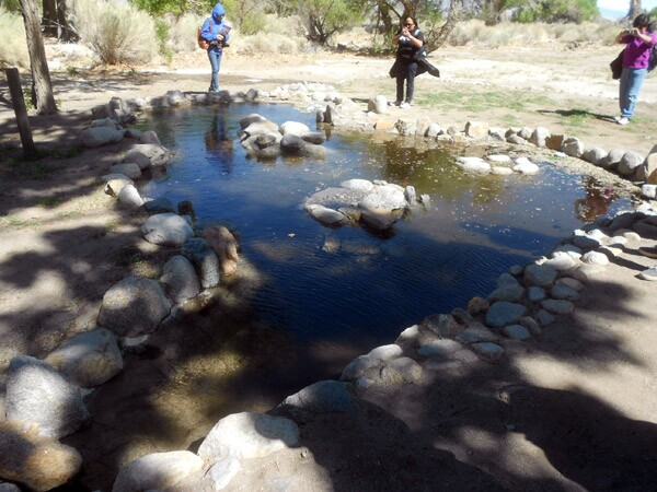 The Arai family fish pond in Manzanar's Block 33, filled with water for the first time since 1945.
