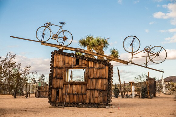 "Noah Purifoy, ""No Contest (bicycles),"" 1991. Assemblage sculpture. 168 x 252 x 24 in. Noah Purifoy Foundation."