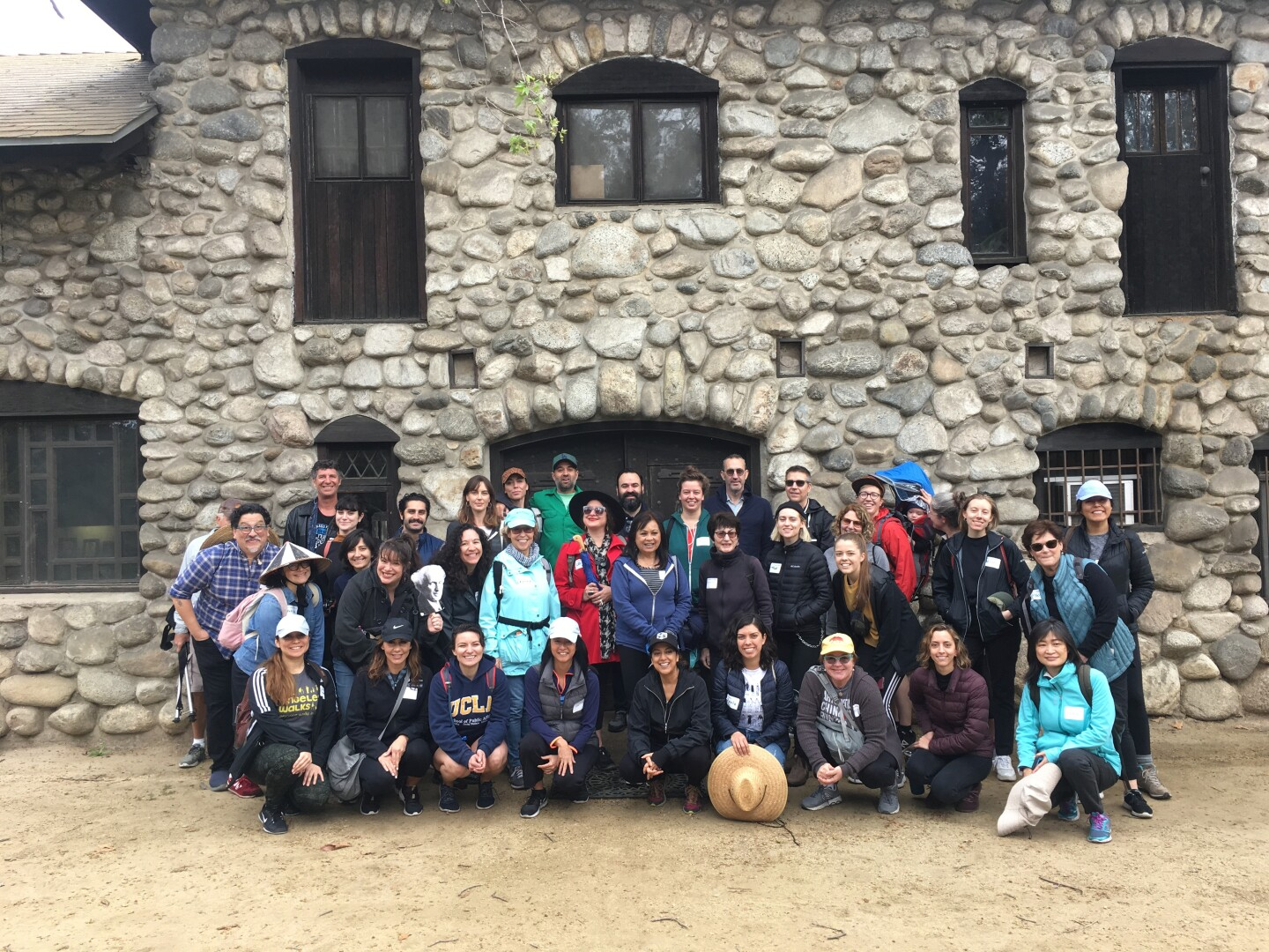 The people who participated at the #LA4Corners walk gather to pose in front of the Charles Lummis House in 2020.