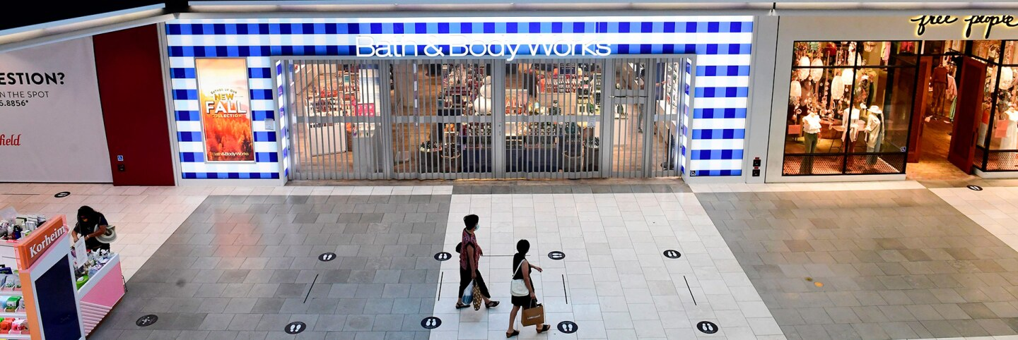 Signs are placed on the floor to direct traffic and observe social distancing guidelines inside the Westfield Santa Anita shopping mall in Arcadia, California on October 7, 2020. | FREDERIC J. BROWN/AFP via Getty Images
