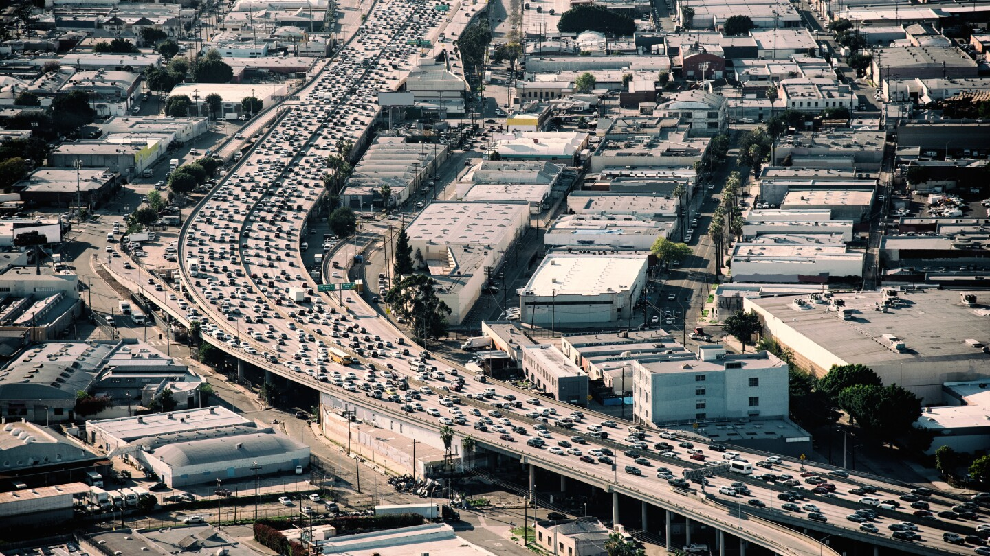 Heavy traffic during rush hour on Interstate 10 near downtown Los Angeles California during late afternoon.