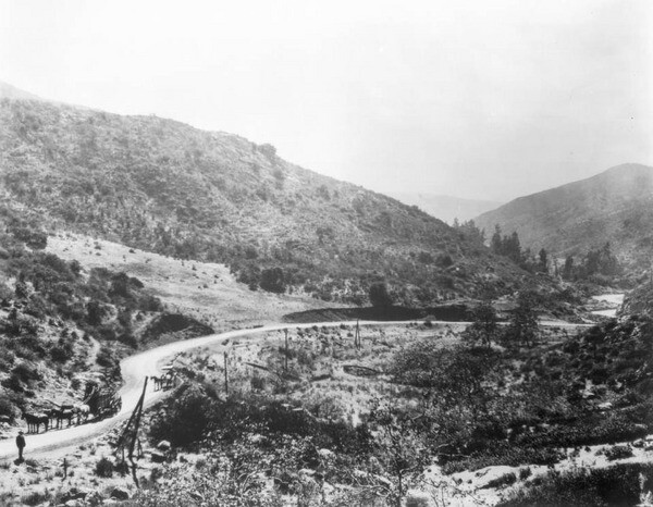 The Cahuenga Pass circa 1905, when only a modest wagon road cut through the gap in the mountains. Courtesy of the USC Libraries - California Historical Society Collection.
