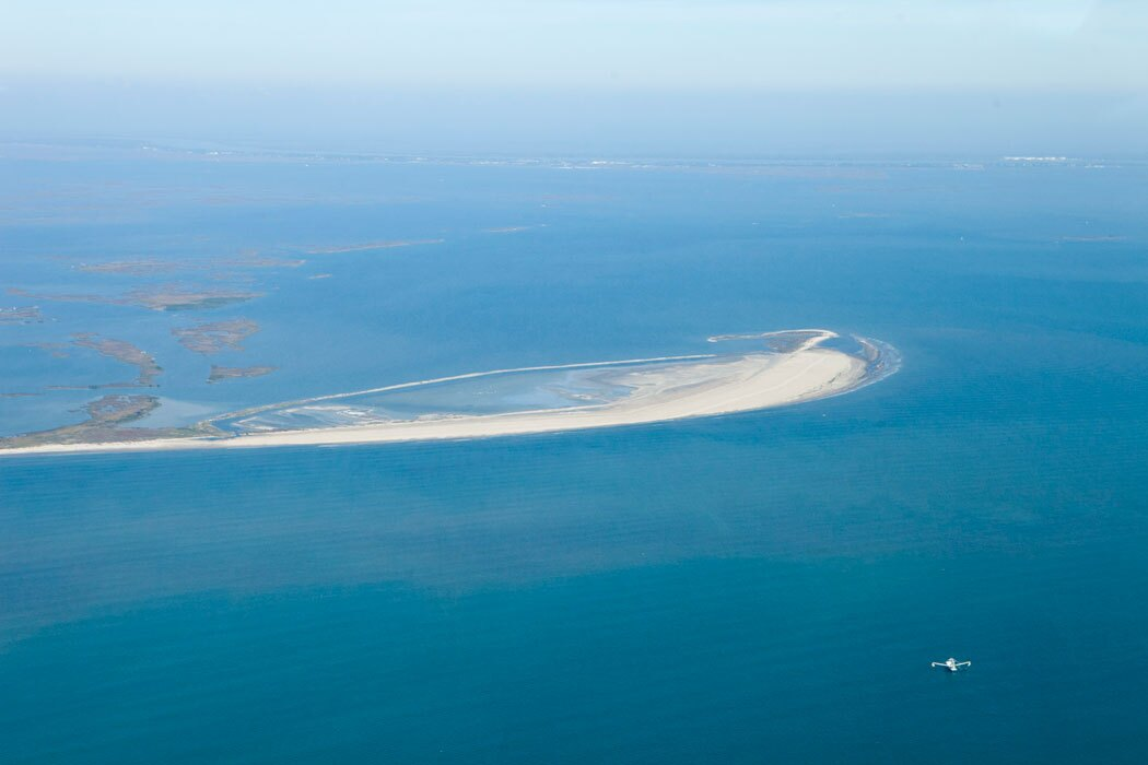 Barrier islands such as this one off the Louisiana coast are one of the first lines of defense against dangerous storms.  | Nicky Milne/Thomson Reuters Foundation