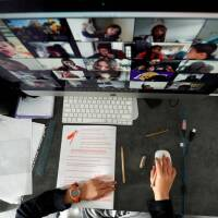 A student takes classes online with his companions using the Zoom app at home during the coronavirus disease (COVID-19) outbreak in El Masnou, north of Barcelona, Spain April 2, 2020.   REUTERS/ Albert Gea