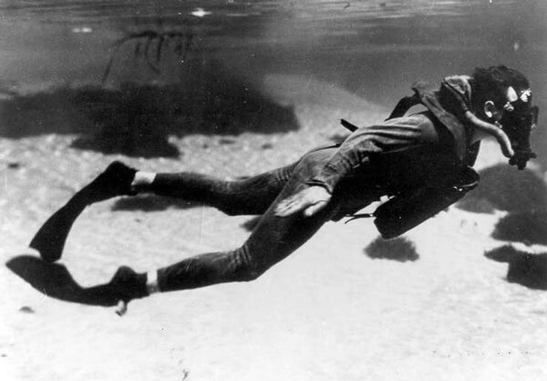 A member of the OSS's Maritime Unit swims underwater with an early SCUBA device and flexible fins developed specially for the clandestine service. Courtesy of the Catalina Island Museum.