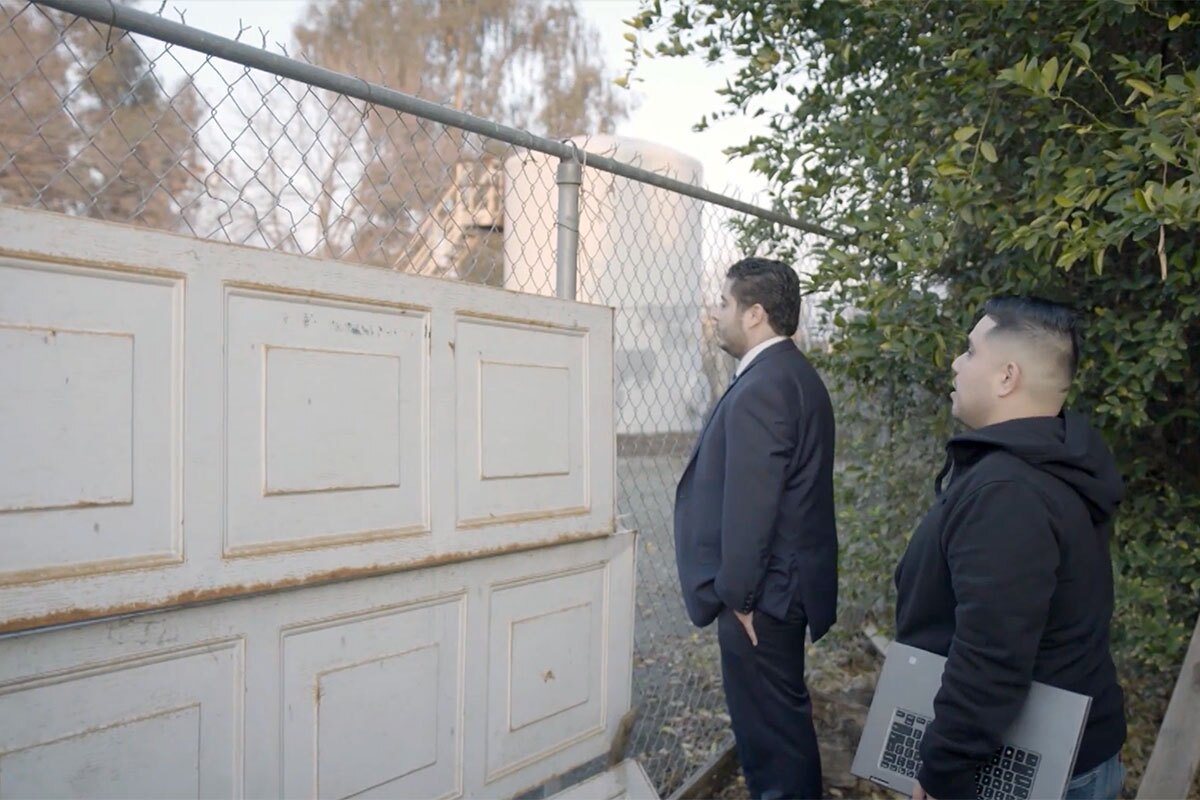 """Gustavo Aguirre, Jr. of the Central California Environmental Justice Network shows Arvin Mayor Jose Gurrola the site of a gas leak. 