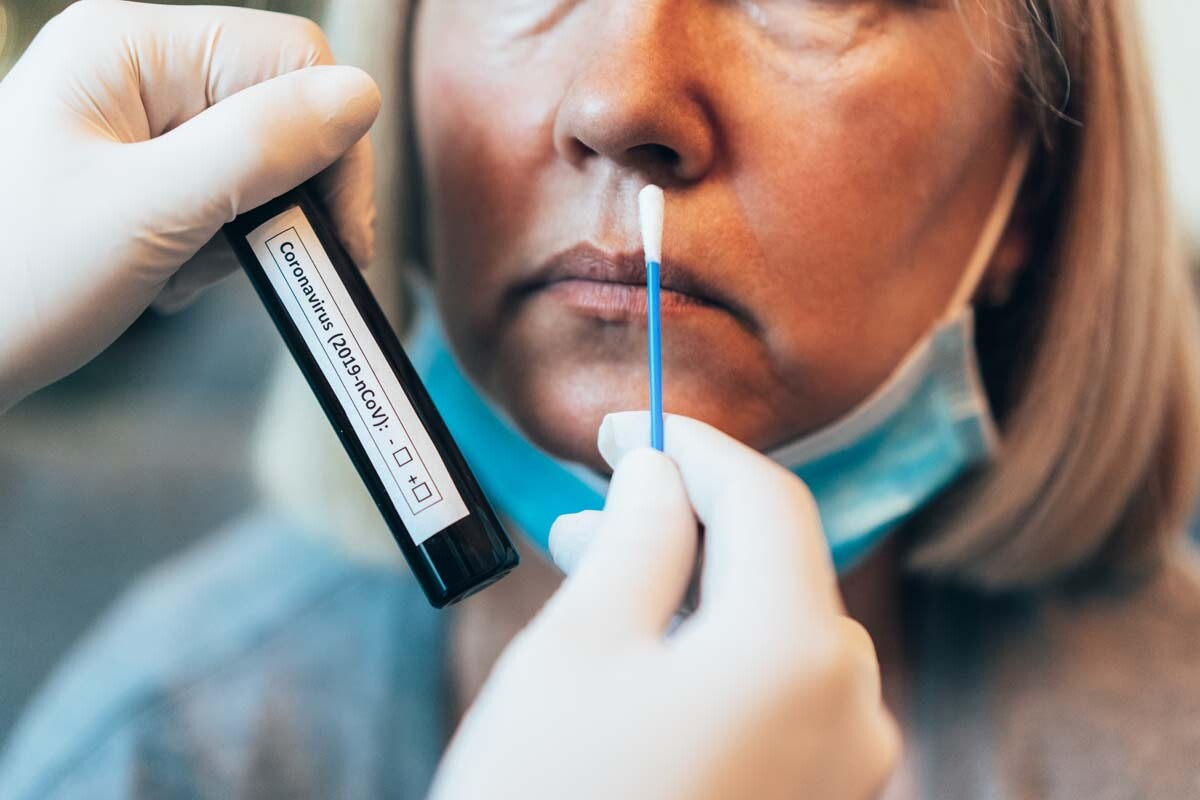 A woman is swabbed to test for COVID-19 | iStock