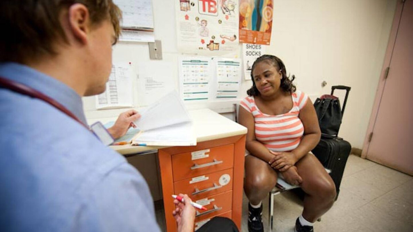A homeless patient consults with medical personnel at a clinic in Nashville, Tennessee, in 2010. Handout photo by National Health Care for the Homeless Council.