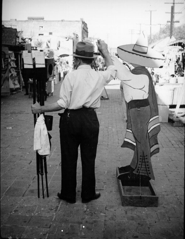 Photographer with traditional Mexican Cutout   Photo: Herman Schultheis, courtesy of Los Angeles Public Library
