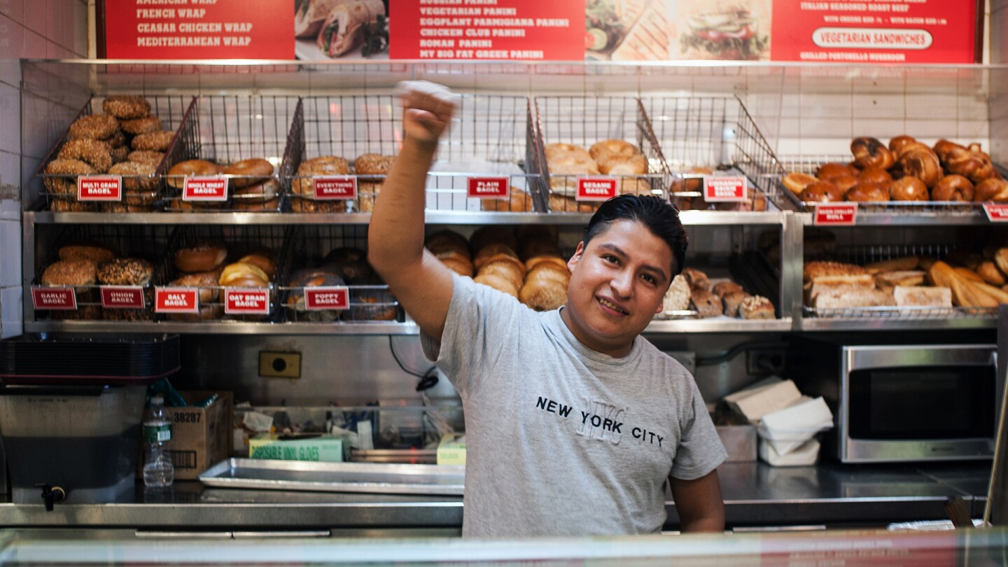 "A bakery worker waves his fist. | Still from ""America ReFramed: The Hand That Feeds"""
