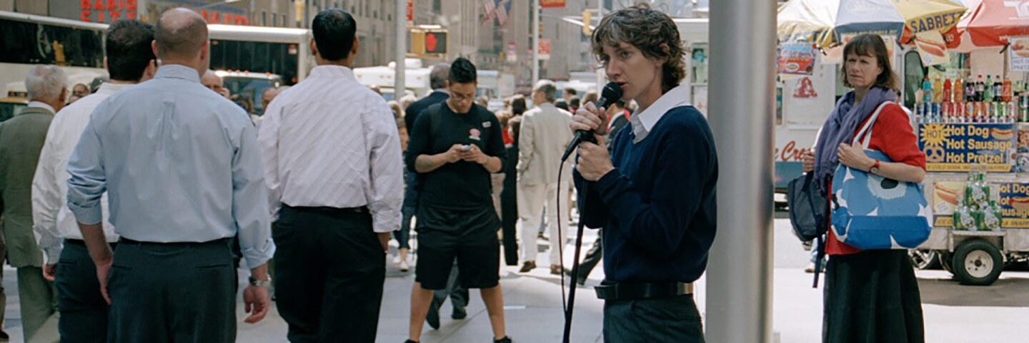 """Sharon Hayes performs """"Everything Else Has Failed! Don't You Think It's Time For Love?"""" (2007), a work staged on a Manhattan street corner where Hayes read texts directed to an anonymous lover.   Courtesy of UCLA"""